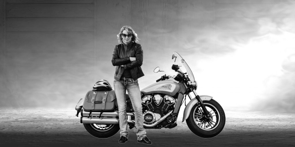 Andi-sitting-on-her-motorcycle-1-1